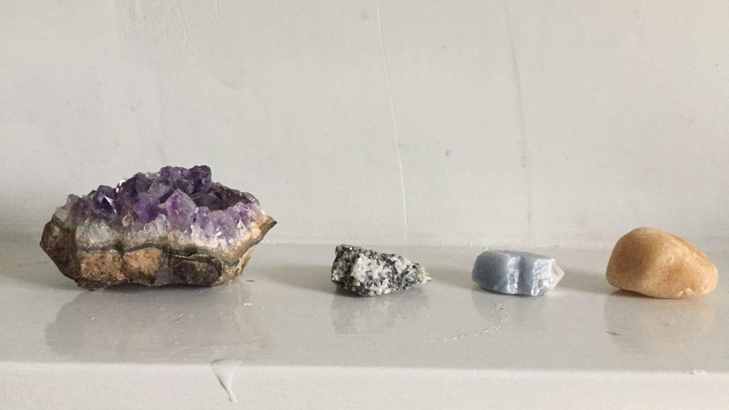 Crystal stones on a shelf