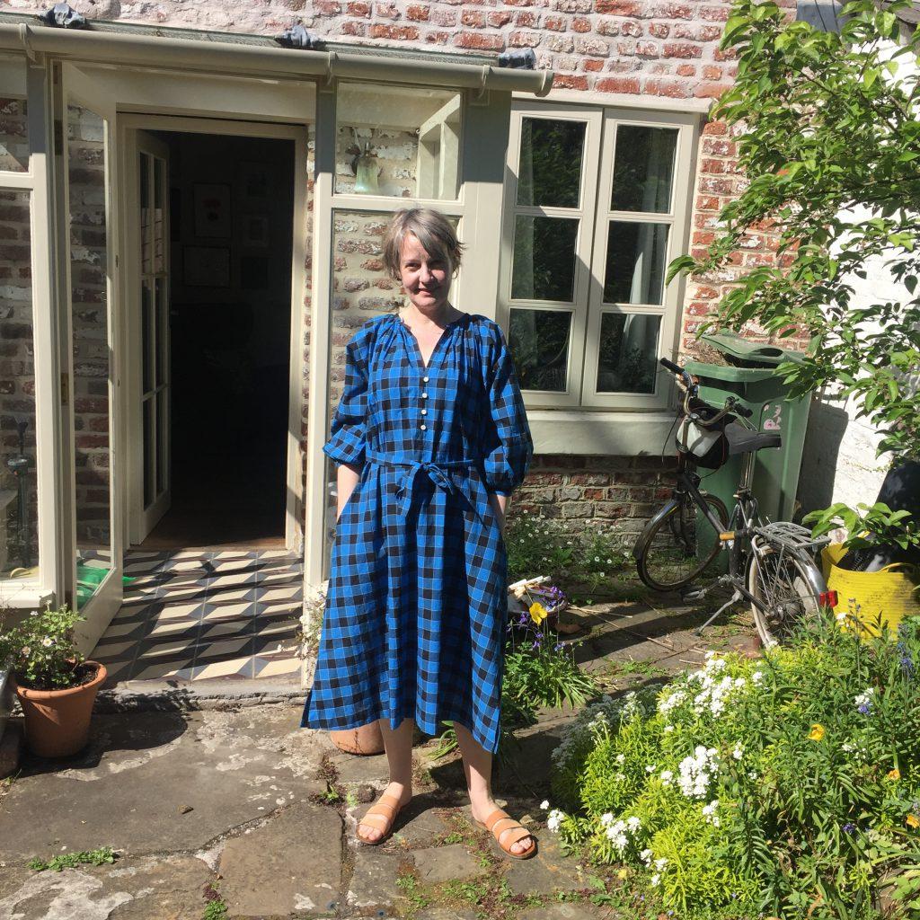 Gillian standing in garden ourside her house